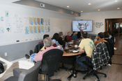 The first meeting was held in the new Annapolis office's conference room.