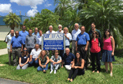 Everglades workshop participants standing in front of Ft. Lauderdale Research and Education building sign.