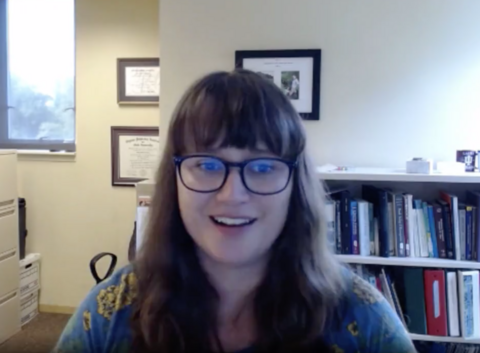 A google meet screenshot of Dr. Laura Johnson speaking about the report card from her office.