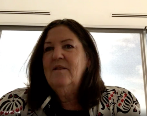 A google meet screenshot of Tina Wozniak speaking about the report card from her office.