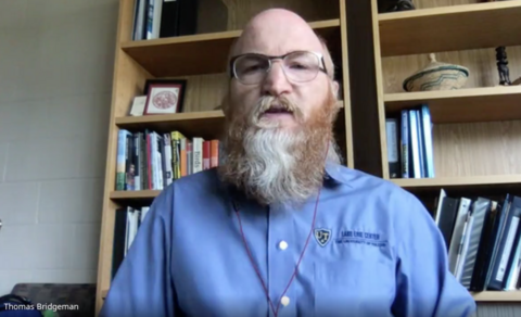 A google meet screenshot of Dr. Tom Bridgeman speaking about the report card from his office.