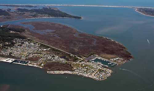 The southern end of Chincoteague Island in Chincoteague Bay. Assateague Island is visible in the background.