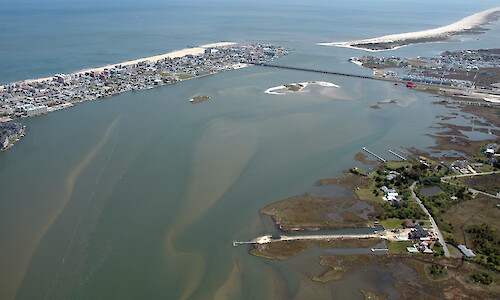 Aerial view of the Ocean City Inlet from Isle of Wight Bay. Also visible are Skimmer Island, the northern end of Assateague Island and Sinepuxent Bay, and the Route 50 bridge.
