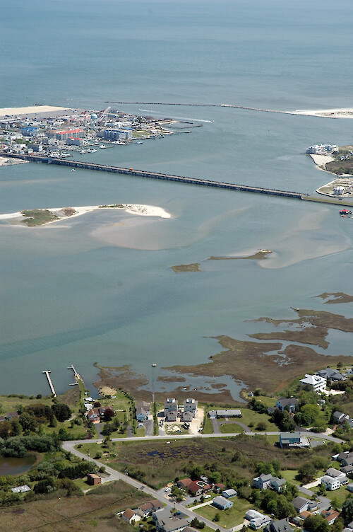 Aerial view of the Ocean City Inlet from Isle of Wight Bay. Also visible are Skimmer Island, the northern end of Assateague Island, and the Route 50 bridge.