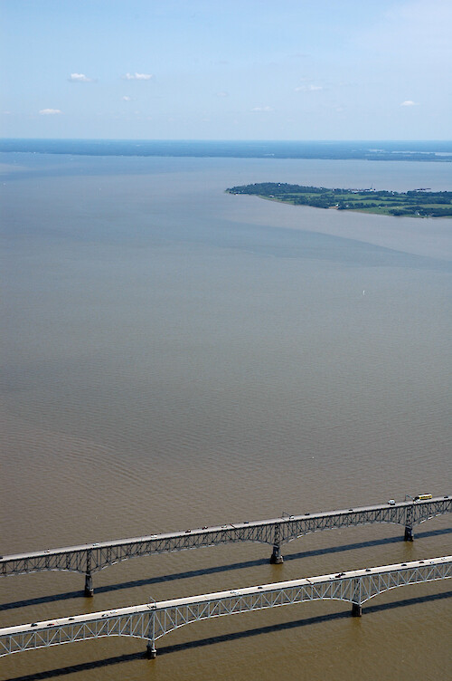 Sediment-laden plumes of water around the Chesapeake Bay Bridge following the recent flooding and extensive rains of June-July 2006.
