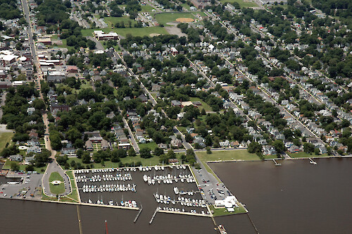 The historic district of Cambridge, Maryland. In the foreground is the marina at Long Wharf