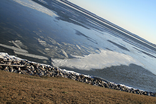 Ice on rip rap along the Choptank River behind Center Administration