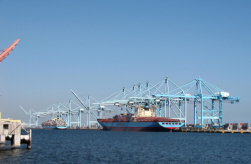 Cargo bardge and cranes at Los Angeles Harbor.