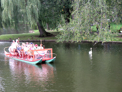 Passengers on the swan boats in the Public Gardens of Boston.