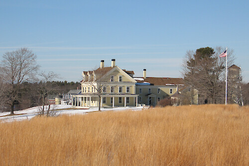 View of the historic salt marsh farm house which now serves as the Visitor Center at the Wells National Estuarine Research Reserve in Wells, Maine.